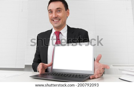 advertisement, business and technology concept. Smiling businessman with blank laptop screen