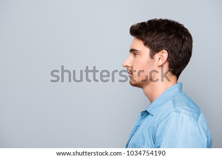 Advertisement concept, side view half face profile with copy space of perfect man standing over gray background