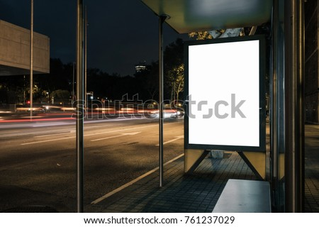 Advertisement light box mock-up at a bus stop at night. Marketing design. #761237029