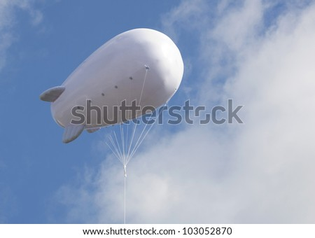 Advertising balloon with free space high in the sky