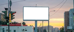 Advertising billboard advertising large horizontal screen MOCKUP for advertising. Against the background of the sunset, glowing.