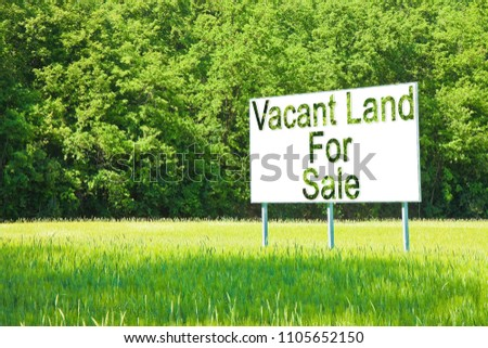 Advertising billboard immersed in a rural scene with Vacant Land for Sale written on it - image with copy space #1105652150