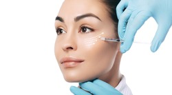 Advertising botulinum toxin injections in the face. Arrows show skin rejuvenation effect, macro