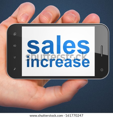 Advertising concept: hand holding smartphone with word Sales Increase on display. Mobile smart phone on Blue background, 3d render