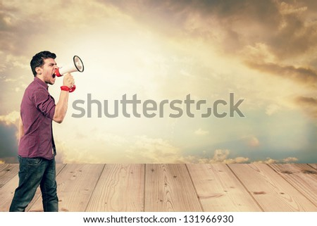 Advertising concept of young adult screaming through a megaphone
