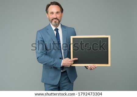 Advertising education. Teacher point finger at school blackboard. Advertising product or service. Advertisement and promotion. Business advertising. Advertisement. Advertising board, copy space.