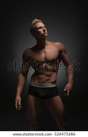 Advertising underwear. Photo of sexy man in briefs #526475686