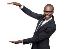 Advertising your product. Happy young African man in formalwear holding large copy space and smiling while standing isolated on white background