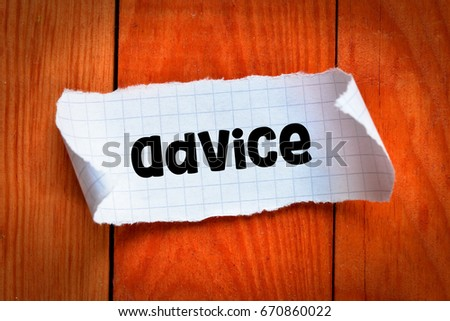 Advice / Note with advice on the wooden background
