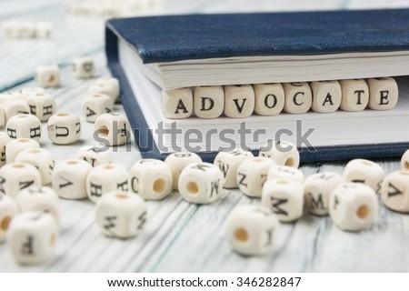 Advocate word written on wood block