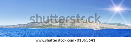Aegean sea and wooden yacht. - stock photo