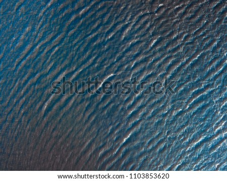 aerial above view of calm ocean water background