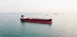Aerial angle side view of oil tanker container ship at sea. Crude oil tanker lpg ngv at industrial estate Thailand - Oil tanker ship to Port of Singapore - import export