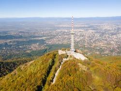 Aerial Autumn view of Kopititoto tower, Vitosha Mountain and city of Sofia, Bulgaria