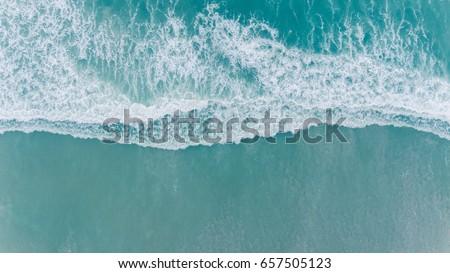 Aerial beach wave on tropical sea #657505123