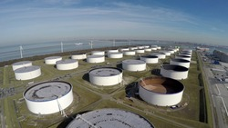 Aerial bird eye view oil depot sometimes called tank farm or oil terminal is industrial facility for storage of oil and petrochemical products ready for transport to further storage facilities
