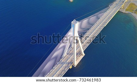Aerial bird's eye drone photo of state of the art suspension bridge crossing the sea #732461983