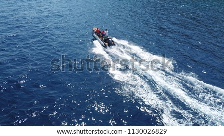 Aerial bird's eye view of inflatable rib boat cruising in high speed in deep blue mediterranean sea #1130026829