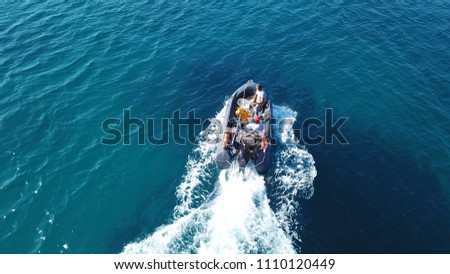 Aerial bird's eye view of inflatable rib boat cruising in high speed in turquoise clear water sea #1110120449