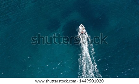 Aerial bird's eye view of inflatable rib boat cruising in high speed in turquoise clear water sea #1449501020