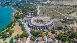 Aerial bird's eye view of the amphitheater in the ancient Side oldtown with sea. Side, Antalya in Turkey