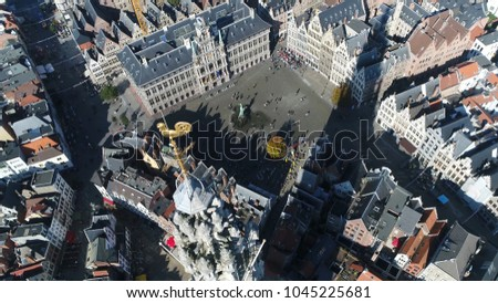 Aerial bird view photo Cathedral of Our Lady in Dutch Onze-Lieve-Vrouwekathedraal Roman Catholic cathedral in Antwerp Belgium also showing Great Market Square City Hall and Guildhalls in background