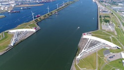 Aerial bird view photo Maeslantkering storm surge barrier on the Nieuwe Waterweg Netherlands it closes if the city of Rotterdam is threatened by floods and is one of largest moving structures on earth