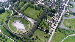 Aerial bird view photo of Amphitheatre of Pompeii is the oldest surviving Roman amphitheater and is located in the ancient city and was buried by the eruption of Vesuvius in 79 AD