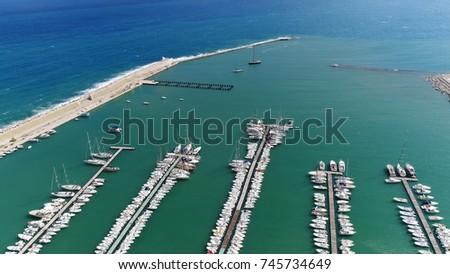 Aerial bird view photo of Gulf of Castellammare marina showing the white docked pleasure yachts and beautiful azure blue mediterranean ocean water Golfo di Castellammare is popular tourist attraction #745734649