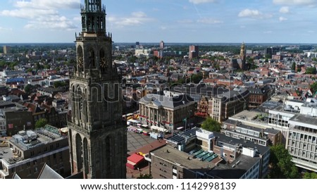 Aerial bird view photo of Martinitoren also called the St. Martin's Tower is highest church steeple in city of Groningen Netherlands and the bell tower of the Martinikerk als showing Grote Markt
