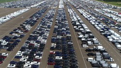 Aerial bird view picture of automaker car lot the automotive industry is wide range of companies and organizations involved in design development manufacturing marketing and selling of motor vehicles