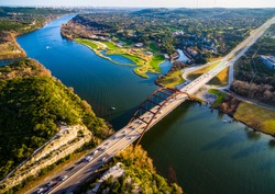 Aerial birds eye view high above The Pennybacker Bridge also known as the 360 Bridge is an Austin Texas Landmark. The paradise summer destination in central Texas
