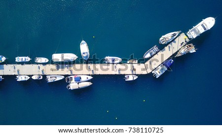Stock Photo Aerial birds eye view photo taken by drone of boats docked in tropical port