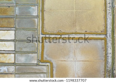 Aerial birds view from the sky of a salt pans fileds structure and arhitecture pattern in Slovenia, Strunjan