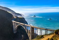 Aerial Bixby Bridge (Rocky Creek Bridge) and Pacific Coast Highway near Big Sur in California, USA America. Drone Shot