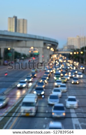 Aerial blurred image of traffic along in Bangkok,Thailand. High-occupancy vehicle lane used at peak travel times. Urban infrastructure problem.   #527839564