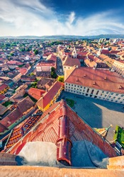 Aerial cityscape photography. Sunny evening view of Altemberger House - Sibiu History Museum. Picturesque cityscape of Sibiu town. Attractive summer scene of Transylvania, Romania, Europe
