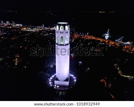 Aerial cityscape view of San Francisco at night. Coit Tower