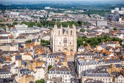 Aerial cityscape view with beautiful buildings and saint Pierre cathedral in Nantes city during the sunny weather in France