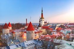 Aerial cityscape with Medieval Old Town, St. Olaf Baptist Church and Tallinn City Wall in the morning, Tallinn, Estonia
