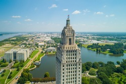 Aerial closeup of the Louisiana State Capitol Building and welcome center in Baton Rouge