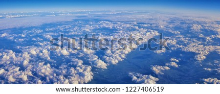 Aerial Cloudscape view over midwest states on flight over Colorado, Kansas, Missouri, Illinois, Indiana, Ohio and West Virginia during autumn. Grand sweeping views of landscape and clouds. Views of cr #1227406519