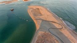 Aerial. Dredger on Ria Formosa, near the village Fuseta.
