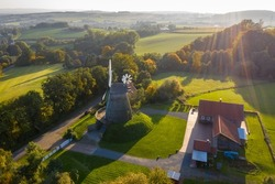 Aerial drone beautiful view on old traditional windmill in middle autumn. Germany  rural landscape in sunny fall evening.