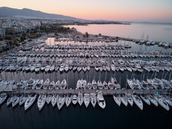 Aerial drone bird's eye view of marina in Athens with docked yachts.