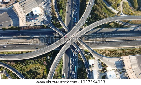 Aerial drone bird's eye view of popular highway of Attiki Odos multilevel junction road, passing through National motorway in traffic jam, Attica, Greece