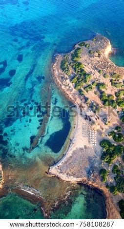 Stock Photo Aerial drone bird's eye view of tropical islet with turquoise and sapphire clear waters