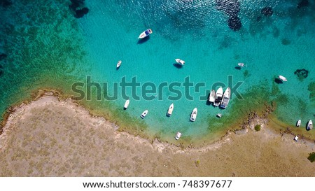 Stock Photo Aerial drone, bird's eye view of tropical rocky seascape with turquoise and sapphire waters