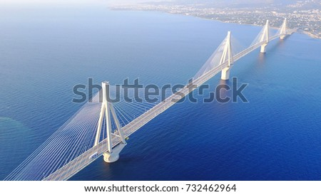 Aerial drone bird's eye view of  world's second longest cable-stayed Suspension bridge crossing Corinth Gulf, Greece #732462964