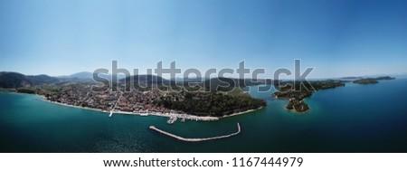 Aerial drone bird's eye view panoramic photo of iconic village of Vonitsa, Etoloakarnania, Greece #1167444979